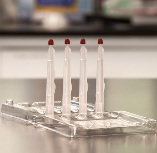 The Mitra Clamshell with 4 sampler tips in a laboratory setting