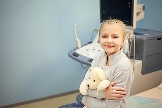 a pediatric clinical trial patient waiting in a medical waiting room