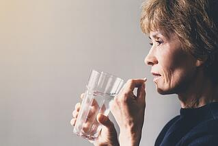 An elderly clinical trial participant adhering to medication adherence
