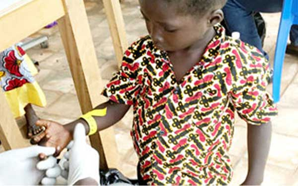 A young boy has a blood sample taken from his finger.  Capillary blood sampling is now becoming a more viable alternative to venipuncture. Give your vulnerable populations a less stressful way to collect blood samples.