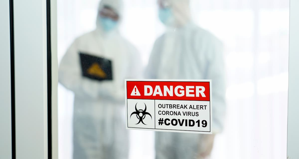 Covid19-two people-dressed-in-protective-suits -cdc